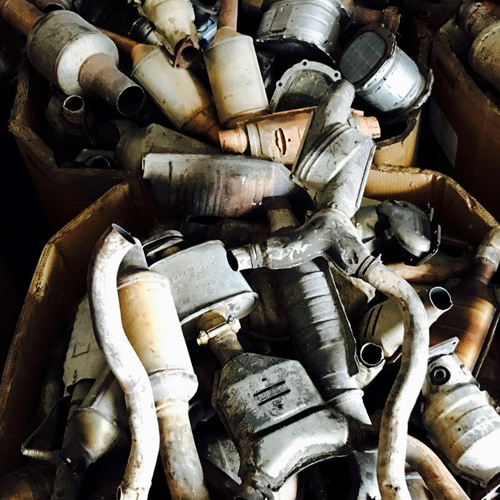 Image of scrap Catalytic Converters in a pile